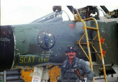 COL Robin Olds and his weapon of choice.png