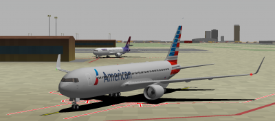 AA 763ER in the foreground (me) and HA 763ER (Greenhorn) after arrival on RWY 08. In the background is the Phoenix skyline and the Cardinals stadium.