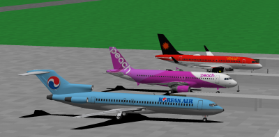 Daishi in the KAL 727-200, me in the Peach 320-200 and decaff in the Stellar CS 100. Parked at Fukushima. We're a colourful trio aren't we? :P